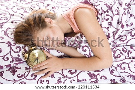 Young woman sleeping in bed in the morning. - stock photo