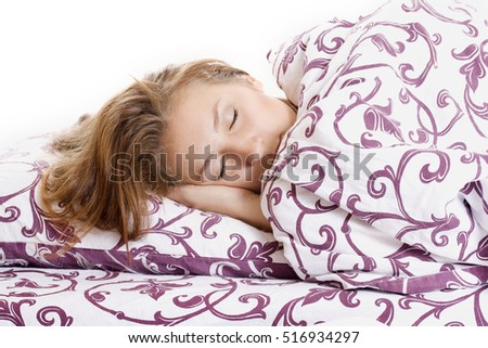 Young woman sleeping in bed in the morning.