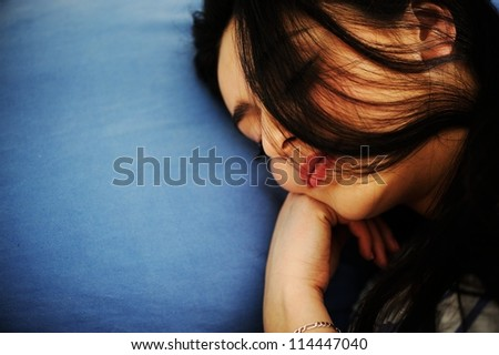 Young woman sleeping on bed - stock photo
