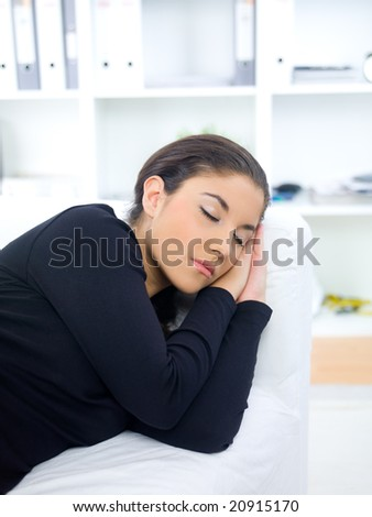Young woman sleeping on couch at her home