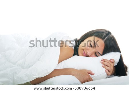 Young woman sleeping on white bed isolated on white background