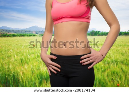 Young woman slim belly closeup - stock photo