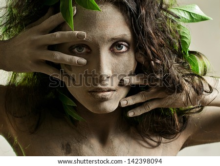 young woman, smeared with clay - stock photo