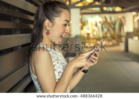 Young woman smile happy using smart phone