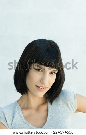 Young woman, smiling at camera, portrait - stock photo
