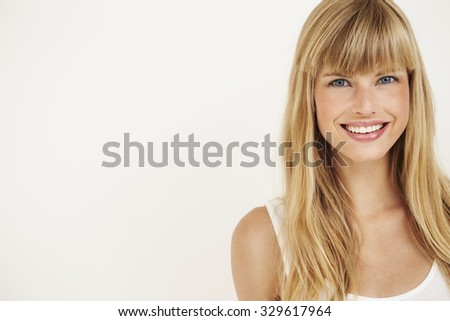Young woman smiling at camera, portrait - stock photo