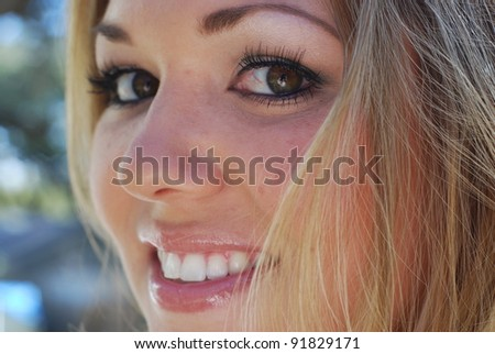 Young woman smiling face - stock photo