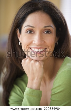 Young woman smiling for the camera - stock photo