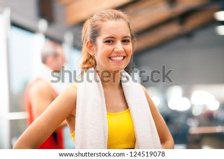 Young woman smiling in a fitness club - stock photo