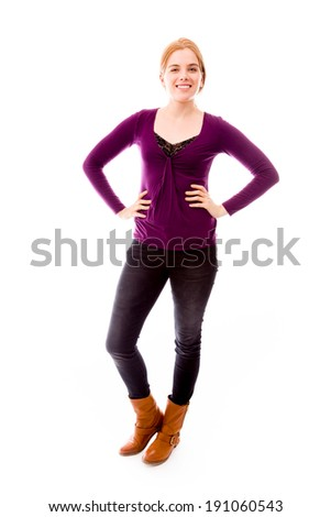 Young woman smiling with her arms akimbo