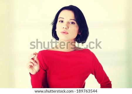 Young woman smoking electronic cigarette (ecigarette) - stock photo