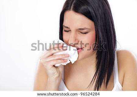 Young woman sneezing, flu or allergy symptoms - stock photo