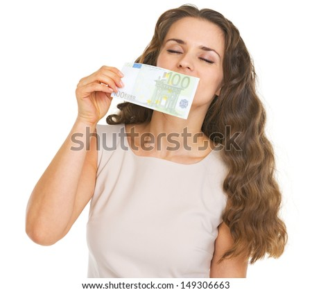 Young woman sniffing one hundred euros banknote