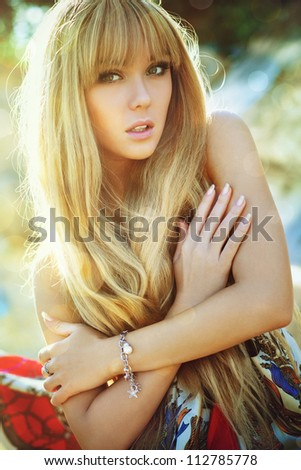Young woman soft outdoors portrait. - stock photo