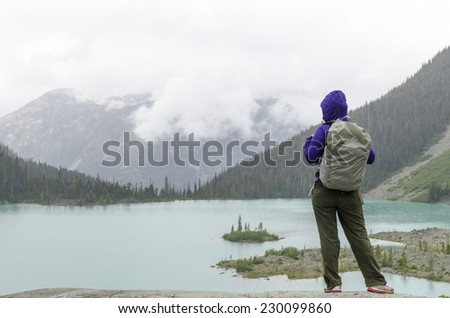Young woman solo hike - stock photo