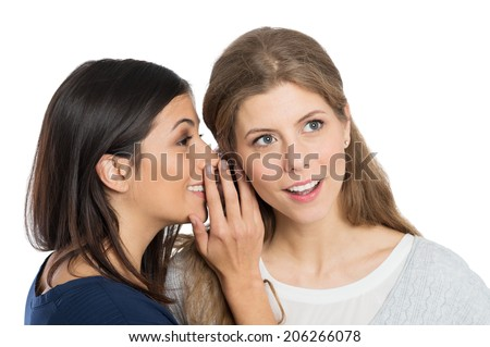 Young Woman Speak Into The Ear Into Ear Of Her Friend - stock photo