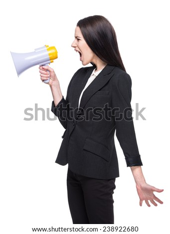 Young woman speaks in a megaphone on white background.