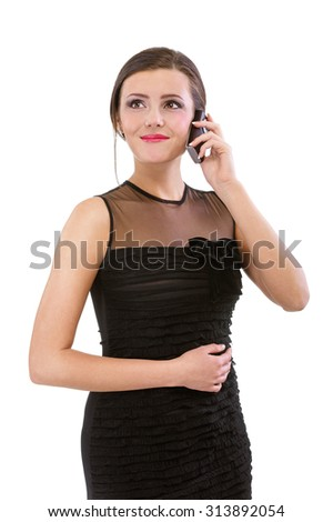 Young woman speaks on phone, isolated on white background. - stock photo