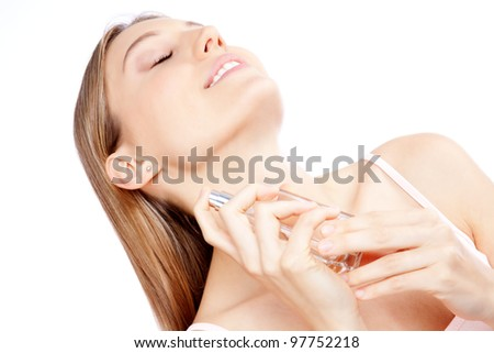 Young woman spraying bottle of perfume. - stock photo