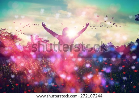 Young woman spreading hands with joy and inspiration facing the sun,sun greeting,freedom concept,bird flying above sign of freedom and liberty,heart bokeh,female liberty - stock photo