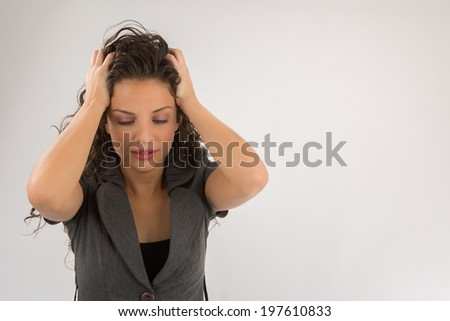 Young woman squeezing your head with your hands  Thinking, tired