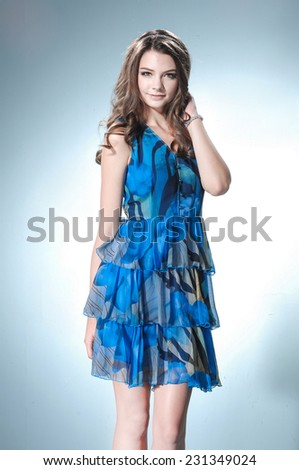 Young woman standing against on light background - stock photo