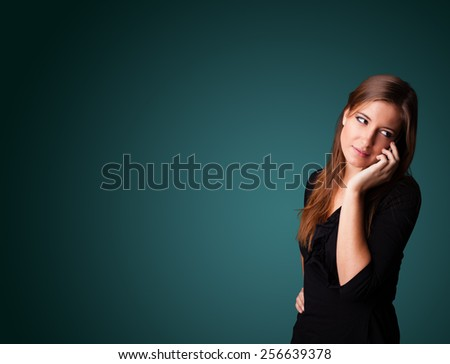 Young woman standing and making phone call with copy space - stock photo