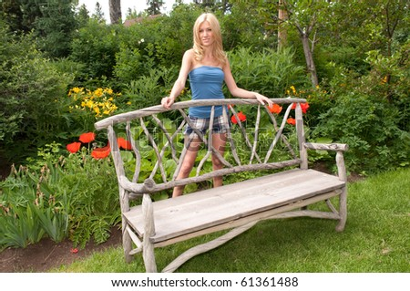 Young Woman Standing Behind Bench
