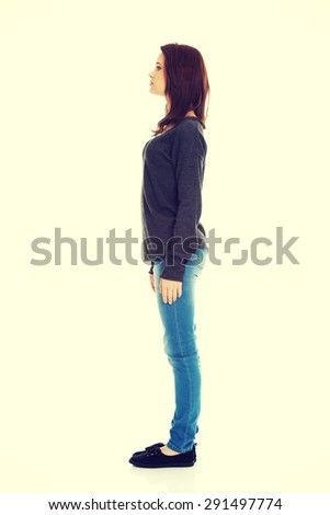 Young woman standing from one side - stock photo