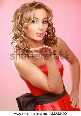 Young woman standing isolated on pink background - stock photo