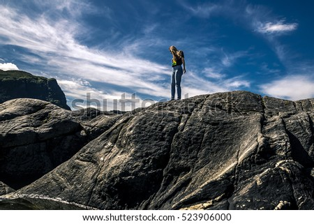 Young woman standing on the rocks, Norway