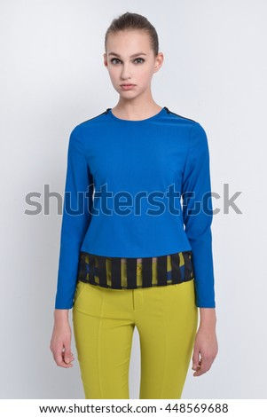 Young woman standing posing  - stock photo