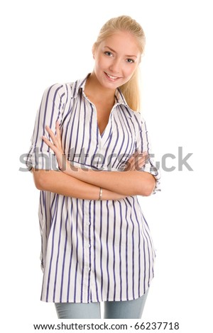 Young woman standing with arms crossed - stock photo
