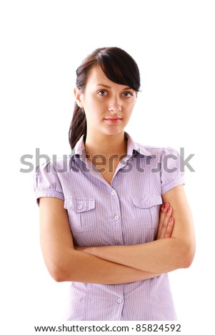 Young woman standing with folded arms isolated