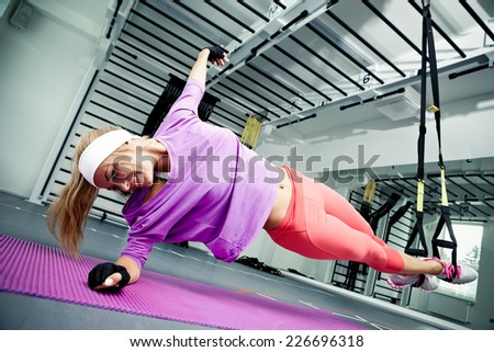 Young woman streching muscles making functional training - stock photo