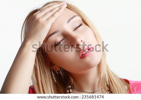 Young woman stressed have a head pain and feels  releaf after pain - stock photo