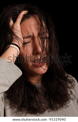 young woman stressed out by splitting headache - stock photo