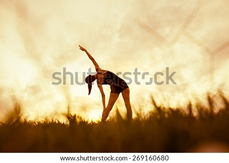 Young woman stretching  - stock photo