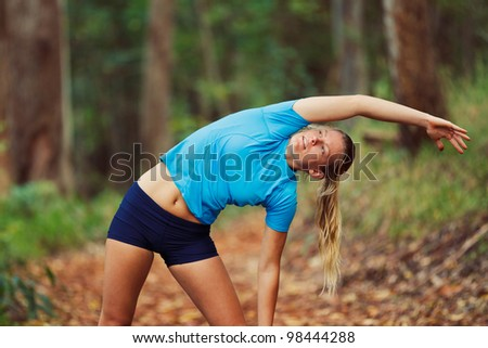 Young Woman Stretching after workout Run - stock photo