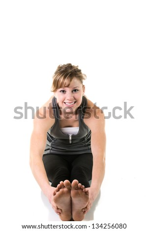 Young woman stretching/exercising - stock photo