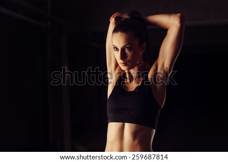 Young woman stretching her arms before gym workout - stock photo