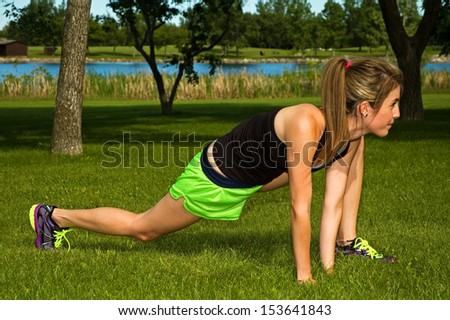 Young woman stretching her hamstring muscle.