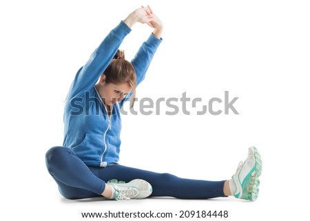 Young woman stretching up hands over white background