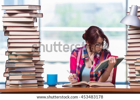 Young woman student preparing for college exams - stock photo