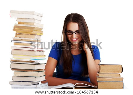 Young woman student with book. Isolated on white.
