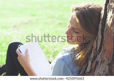 Young woman studing in the park, selective focus