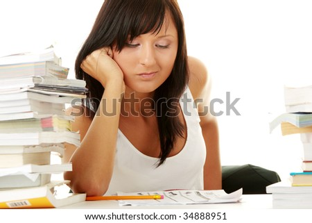 Young woman studying at the desk isolated on white background