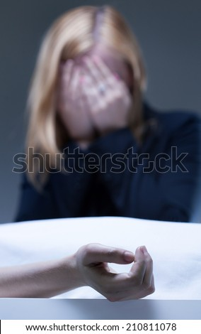 Young woman suffering after death of close relative - stock photo