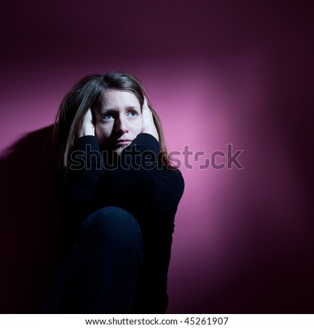 Young woman suffering from severe depression/anxiety - stock photo