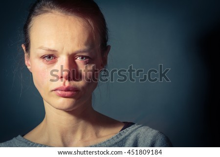 Young woman suffering from severe depression/anxiety/sadness